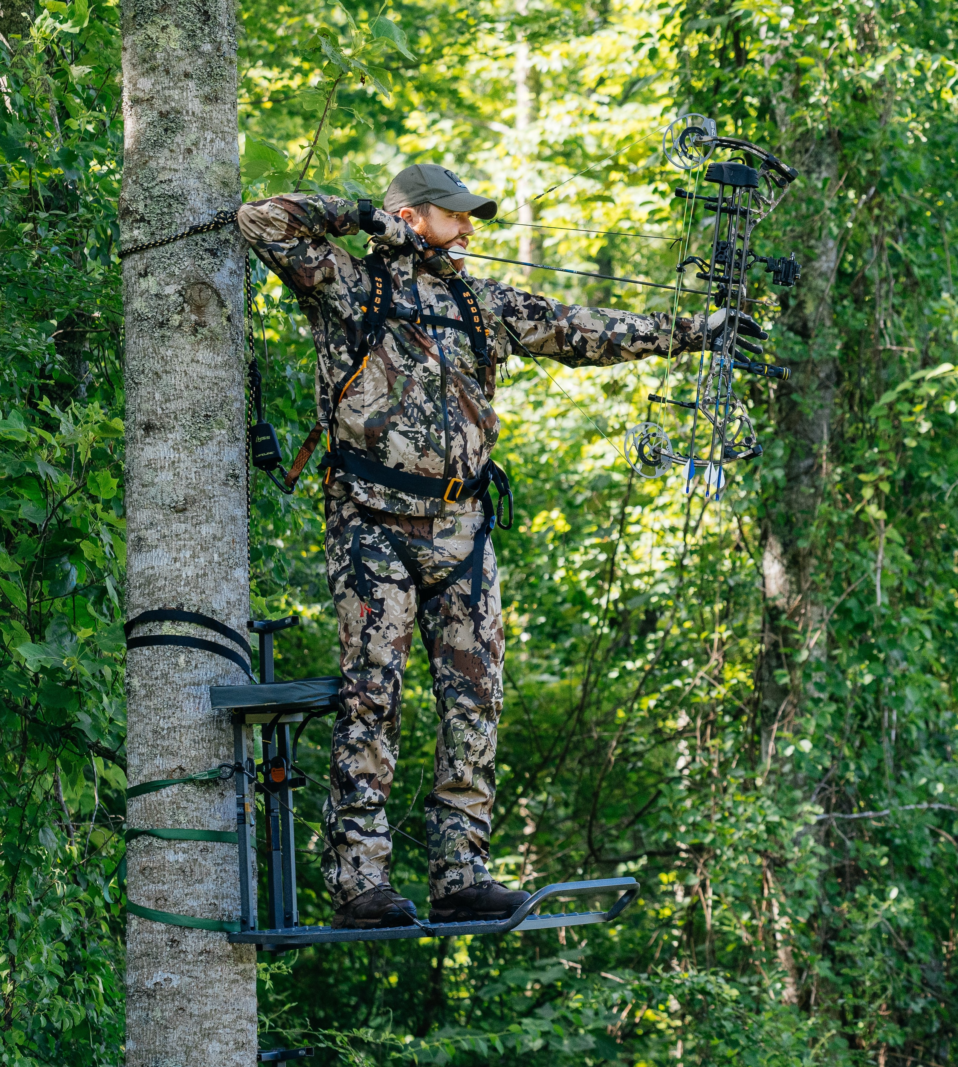 Bowhunter in a hang-on treestand