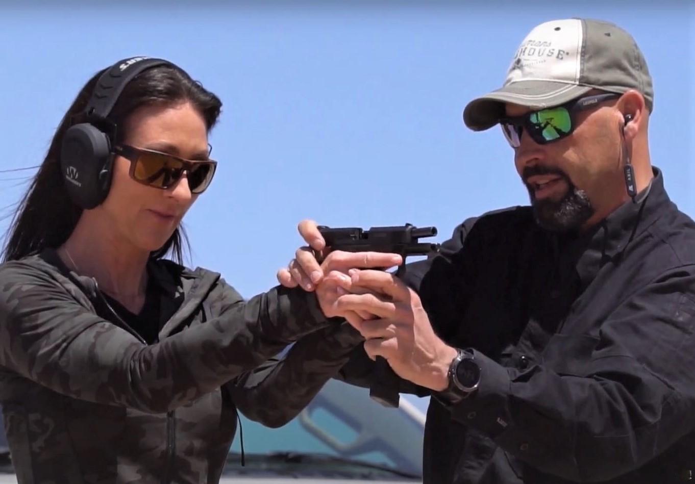 Dan Kidder training a student using a semi-automatic pistol